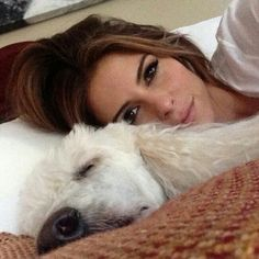 Maria Menounos lounging with her dog