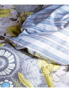 Sew a reversible duvet cover. I more like this tutorial for sewing fabric together description. I could do a duvet cover with the top having three panels. Solid on the outside and patterned on the inside or vice versa