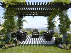 Here's a black pergola with white columns.