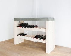 This DIY Wine Bar is made out of 2x4s and Quikrete 5000 concrete mix from Home Depot. Full instructions can be found at HomeMade-Modern.com