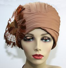 """""""Art Deco cloche hat embellished by an astounding feather design. Look closely…the feathers' stems have amber beading. This is an amazing sable-brown colored vintage hat by 'DORIS Designed'"""""""