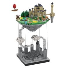 Who has never dreamed of escaping the city to live peacefully on an island floating in the sky ?My project is a microscale construction representing a small island floating above a dark city.The construction is a tensegrity structure. Lego Poster, Floating Island, Small Island, Micro Lego, Amazing Lego Creations, Lego Craft, Lego Castle, Lego Toys, Lego Storage