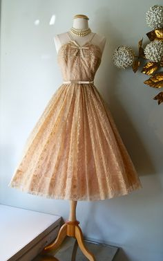 Delicate peach sundress with gorgeous embroidery and tucked bodice