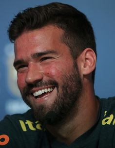 Goalkeeper Alisson smiles during a Brazil press conference ahead of the  FIFA World Cup 2018 in df15b3fac3cb6