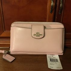 Brand new Coach wallet..soft and beautiful!! Pretty soft pink...luxury!! Coach Bags Wallets