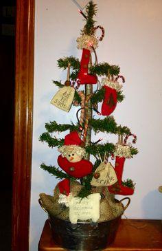 Handmade primitive tree and ornaments I made.  Took about 30 min to make the tree. Made by Cindy's Primitives