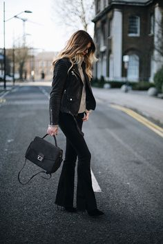 Emma Hill wears black flares, grey suede biker jacket, chic winter outfit
