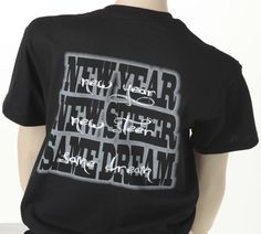 "Our """"New Year, New Steer, Same Dream"""" features a ghosted silhouette with script overlay design. The classic fit black tee reads """"Show Girl"""" across the front with the """"New Year"""" imprint on back."