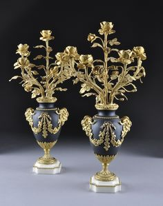 A PAIR OF LOUIS XVI STYLE GILT AND PATINATED BRONZE FIVE LIGHT CANDELABRA, STAMPED MB, THIRD QUARTER 19TH CENTURY, each of vasiform centerin...