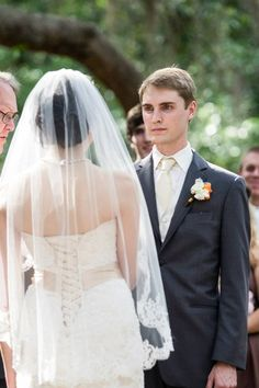 Designer/Planner: Dandy Details Events Groom holding back tears  Gray Suits Stunning Veil with lace detail