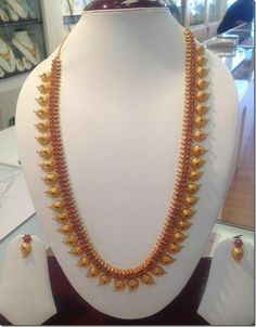 Gold ruby mango long necklace and earrings from New Arun Jewellers. For inquiries please contact 0824 244 Mango Mala Jewellery, Kerala Jewellery, Indian Jewelry, Indian Necklace, Temple Jewellery, Jewellery Box, Gold Jewellery Design, Gold Jewelry, Diamond Jewellery