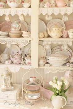 I love the lace!! Beautiful China Cabinet. Dishes with rose pattern; lace edged hankerchiefs and trim.