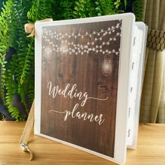 The Rustic Barn Lights covers looks great in a Deluxe Binder with a burlap ribbon bookmark! #rusticbarnweddings #barnwood #weddingplanner #organizedbride