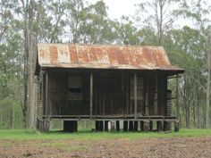 Australian bush hut, vertical timber boards with external bracing.