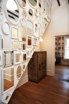 Contemporary Hallway with Gallery wall, Antique armoire, High ceiling, Hardwood floors, Vintage mirror wall, flush light