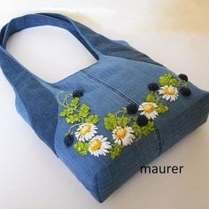 This Embroidered denim bag Jeans bag with ribbons embroidered Recycled fabric sac Summer floral purse Shoulder bagful Eco friendly tote bag is just one of the custom, handmade pieces you'll find in our shoulder bags shops. Denim women's shoulder bag with Denim Tote Bags, Denim Handbags, Denim Purse, Denim Jeans, Denim Skirt, Embroidered Bag, Patchwork Bags, Large Shoulder Bags, Fabric Bags