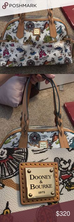 Disney Dooney and Bourke This is a practically new Disney Dooney and Bourke. Maybe used twice, just not my style of bag.  Almost perfect placement Dooney & Bourke Bags Shoulder Bags
