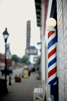 barber pole dates back to the barber surgeon days. The red represents blood, blue represents veins, and white represents bandages.