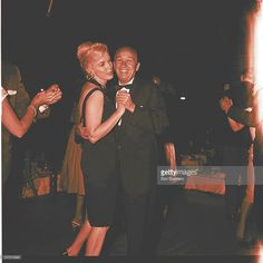 Actress Marilyn Monroe dances with orchestra leader Matty Malneck at a party at the Cal-Neva Lodge at the border of California and Nevada on Lake Tahoe circa August or September 1960. Frank Sinatra, who owned the club, invited the whole cast of the Misfits to party for a night.