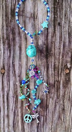 Peace, palm trees and turquoise shimmy for your rear view mirror on Etsy, $20.00