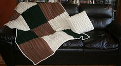 Made with Neutrals and richly textured this afghan and throw pillow can accent any room. Special features include a cozy pocket on the back of the afghan for tucking in chilly feet and buttons on the throw pillow allowing it to be removed for ease of washing.