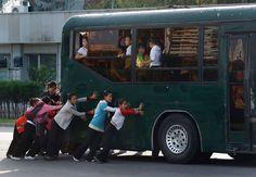 North Korean children push a bus in a street in Pyongyang, North Korea, Sept. 20, 2012. (Vincent Yu/Associated Press) #