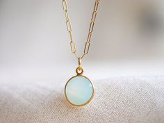 So appealing: the contrast of cool aqua blue and warm gold.