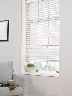 White wooden venetian blinds combined with curtains What do u
