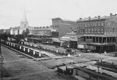 Canal Street 1864. Businesses D H Holmes Dry Goods, James Ryback Fancy Goods, Mrs Charles Brown dress & cloak maker, J Ada Rocha & Co. Old Christ Church  later site of Maison Blanche
