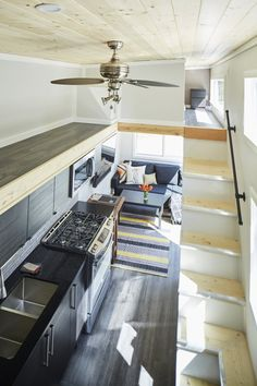 A luxury tiny house from West Coast Outbuildings of North Vancouver. The home fits two bedrooms, a full kitchen, living room, and bathroom in just 400 sq ft!