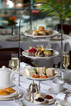 A quiet afternoon tea reception with tea sandwiches, champagne, cheeses, scones, cake, and little desserts.
