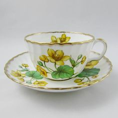 Beautiful Adderley tea cup and saucer. Tea cup and saucer are white with large yellow flowers. Gold trimming on cup and saucer edges. Excellent condition (see photos). Markings read: Adderley Fine Bone China England Please bear in mind that these are vintage items and there may be