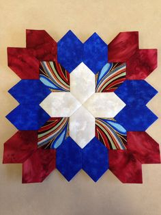 Lucy Boston (POTC/Patchwork of the Crosses) quilt block made with English paper piecing. I didn't originally intend for it to be patriotic looking but I like how it turned out. Just in time for 4th of July!!  By Tracy Pierceall--2014