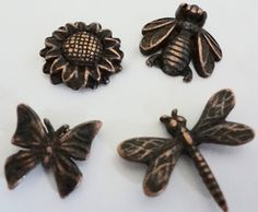 Decorative Spring Time Push Pins. Sunflower, Bumble Bee, Dragonfly and Butterfly. Made in USA of lead free metal.  Has a nail on back to push into soft wood or bulletin board!