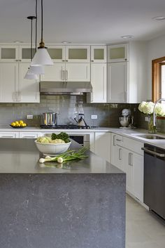 Island with a Waterfall edge treatment brings this beautiful countertop down the side.