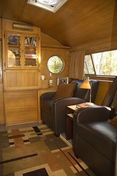 Glamping = Glamorous Camping vintage camper, love the club chairs