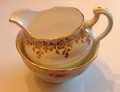 Colclough gold and green creamer and sugar bowl