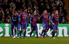 Barcelona's Lionel Messi celebrates scoring his side's first goal of the game during the UEFA Champions League match at Celtic Park Glasgow PRESS...