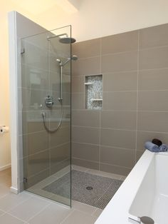 design idea - shower opened up facing bath?