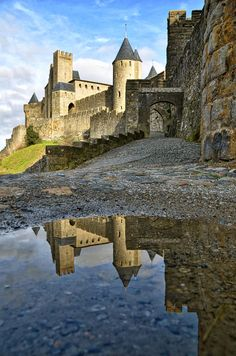 Reflective photo of part of the fortification of Carcassonne, in the south of France. From Roman and medieval period.