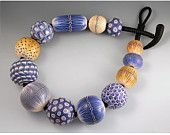 Melanie West. Big Bead Necklace in Shades of Grey, Yellow-Ochre, Soft Greens and Blues.. 665.00$, via Etsy.