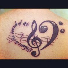 Music Tattoo Designs: Music notes heart tattoo