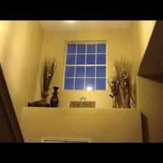 Finally decorated my ledge above the door! Thinking of putting a curtain up? Entryway Light Fixtures, Entryway Lighting, Entryway Decor, Plant Ledge Decorating, Interior Decorating, Decorating Ideas, Ceiling Decor, Wall Art Decor, Wall Ledge