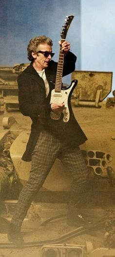 """flydye88: """" In honor of my favorite 12th doctor guitar playing gif. I could watch this all day, I mean look at the those luscious lips. I'm going to go to bed, with the Doctor playing his guitar..."""