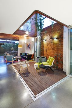 An outdoor space right in the middle of the living room, tree included. Contemporary Deck by elaine richardson architect