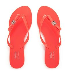Tangerine Flip Flops - Set on a slim rubber sole with a padded footbed, the flip flops feature tonal patent orange straps with a rubberised bow and punctuated with fine gold tone hardware. #footwear #summer #beach #bright #stylish