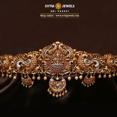 Feel the bliss of this gold oddiyanam/vadanam enlightened with the sculpt of Goddess Lakshmi and peacock on Two sides.This oddiyanam Studded with Cubic Zircone,Swarovski Pearl and Ruby Stones. This does not include the back belt, please contact cu Jewelry Design Earrings, Gold Earrings Designs, Gold Jewellery Design, Gold Jewelry, Saree Belt, Frozen Jewelry, Antique Jewellery Designs, Indian Wedding Jewelry, Bridal Jewelry Sets
