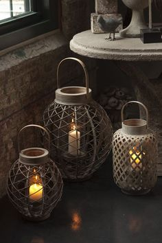 Asian-inspired Garden Lanterns with Glass hurricanes. Three sizes