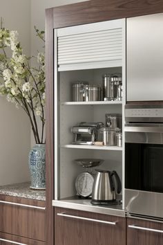 Aluminim tambour cabinet, as shown in the Modern History kitchen by #WoodMode.