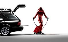 What the hell is happening in this Saab 95 Aero Wagon press photo?! BDSM skiing red Stormtrooper?!!